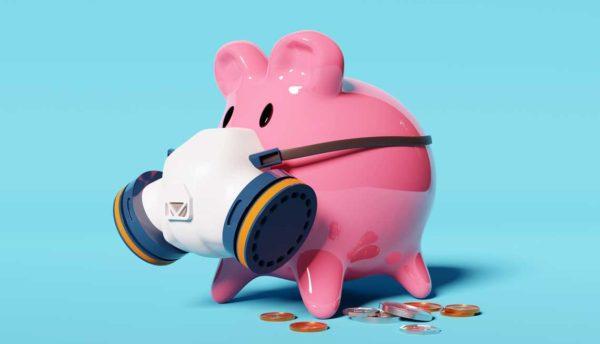 pink piggy bank wearing face respirator