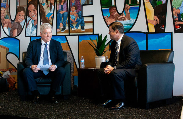 Doug Ducey and Bergman chatting while at On Q Headquarters