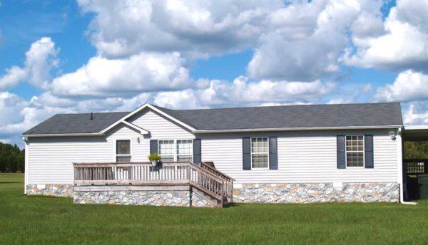 Facade of a house in a grassy plain