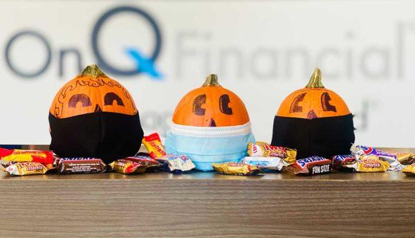 Halloween pumpkins wearing protective masks