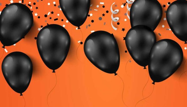 black balloons against an orange background