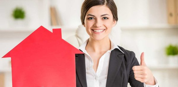 Realtor giving thumbs up to buy a house
