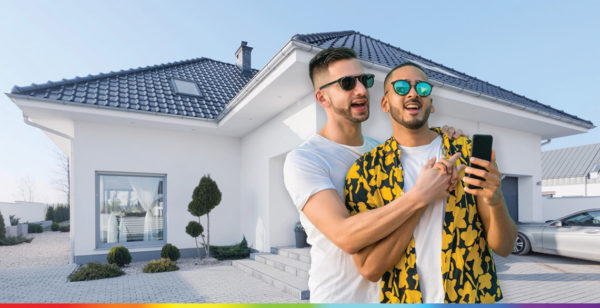 Gay couple celebrating home purchase